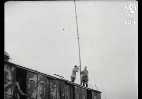 Screenshot of wireless mast being put up from British Pathe film, Wireless Installation On Train (1914-1918).