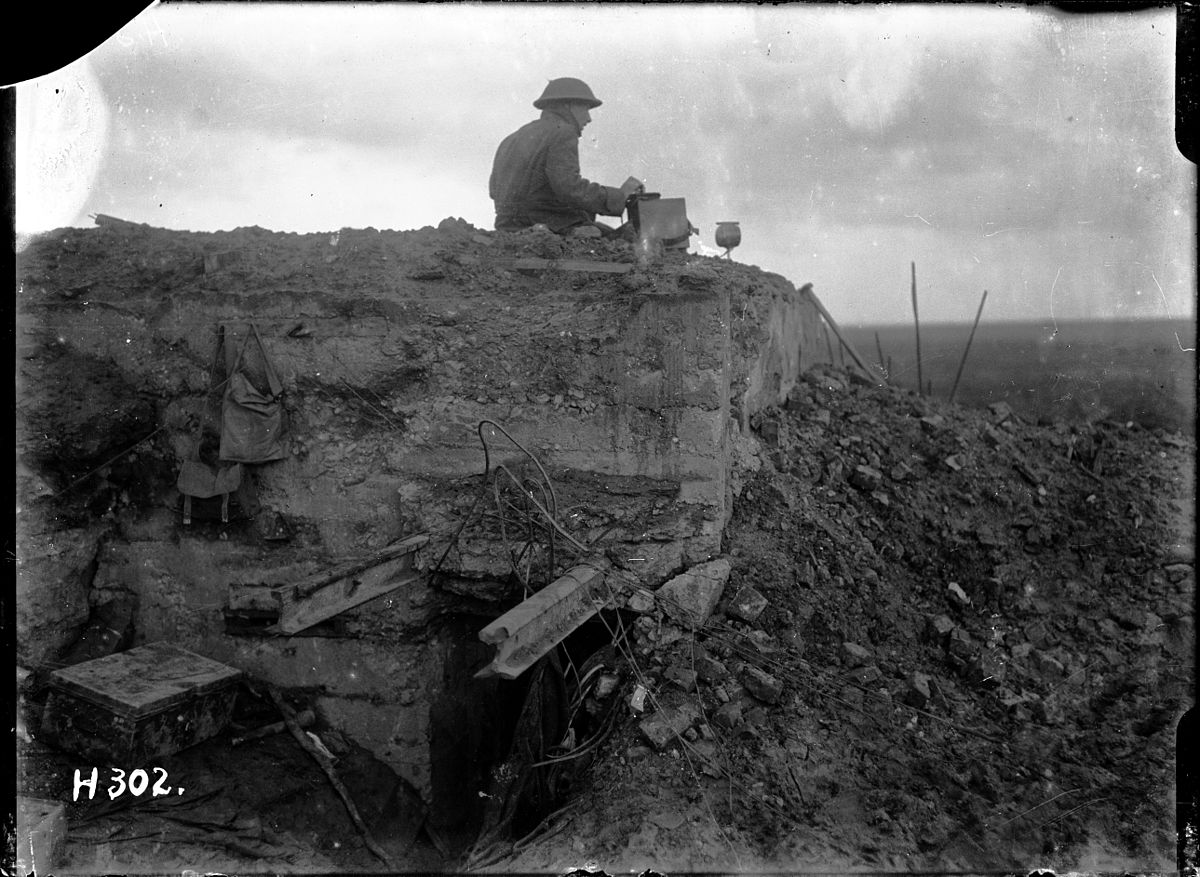 National Library of New Zealand 1/2-012945-G Unidentified New Zealand World War 1 signaller on a German dug-out, Gallipoli Farm, Belgium, 12 October 1917. Photograph taken by Henry Armytage Sanders.