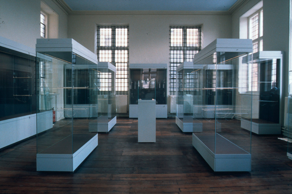 the top gallery of the Museum filled with empty exhibition cases