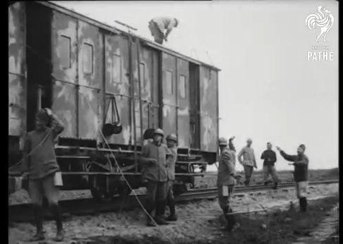 Screenshot of group of soldiers beside the train from British Pathe film, Wireless Installation On Train (1914-1918).