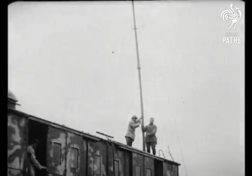 Screenshot of wireless mast being put up from British Pathe film, Wireless Installation On Train (1914-1918).