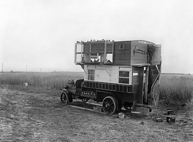 IWM Q6230 Carrier pigeons: A bus converted into a mobile pigeon loft on the Western Front, July 1916.