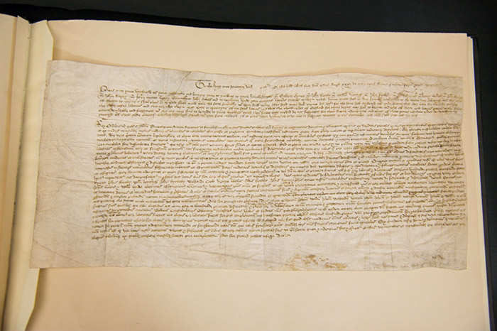 The document consists of the petition itself in English, followed by the draft Latin of the royal Letters Patent providing the necessary legal text. There is also a short memorandum noting that the King approved the petition on 31 May at Richmond.