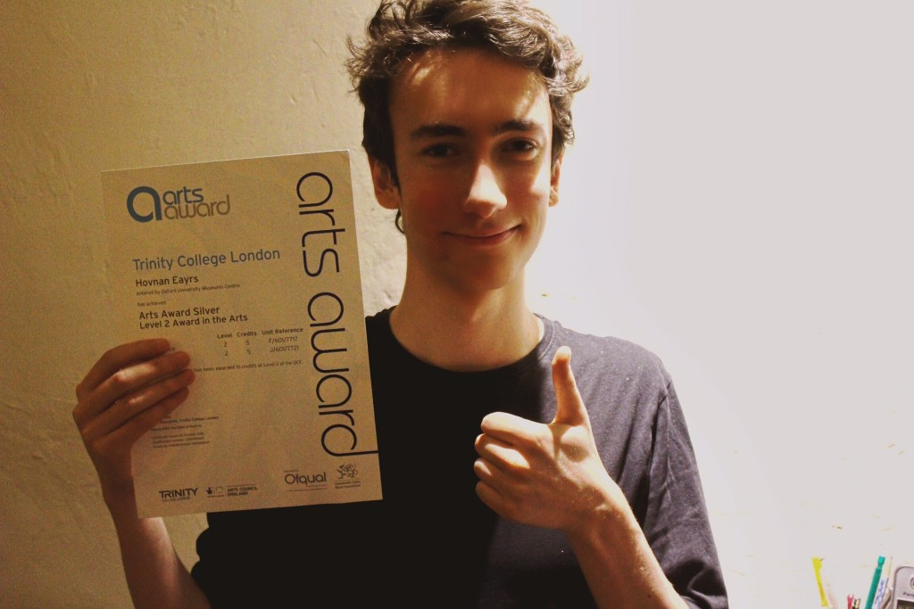 Hovan with his Arts Award Certificate