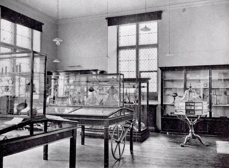 A corner of the top floor of the building showing old wooden cases filled with scientific instruments