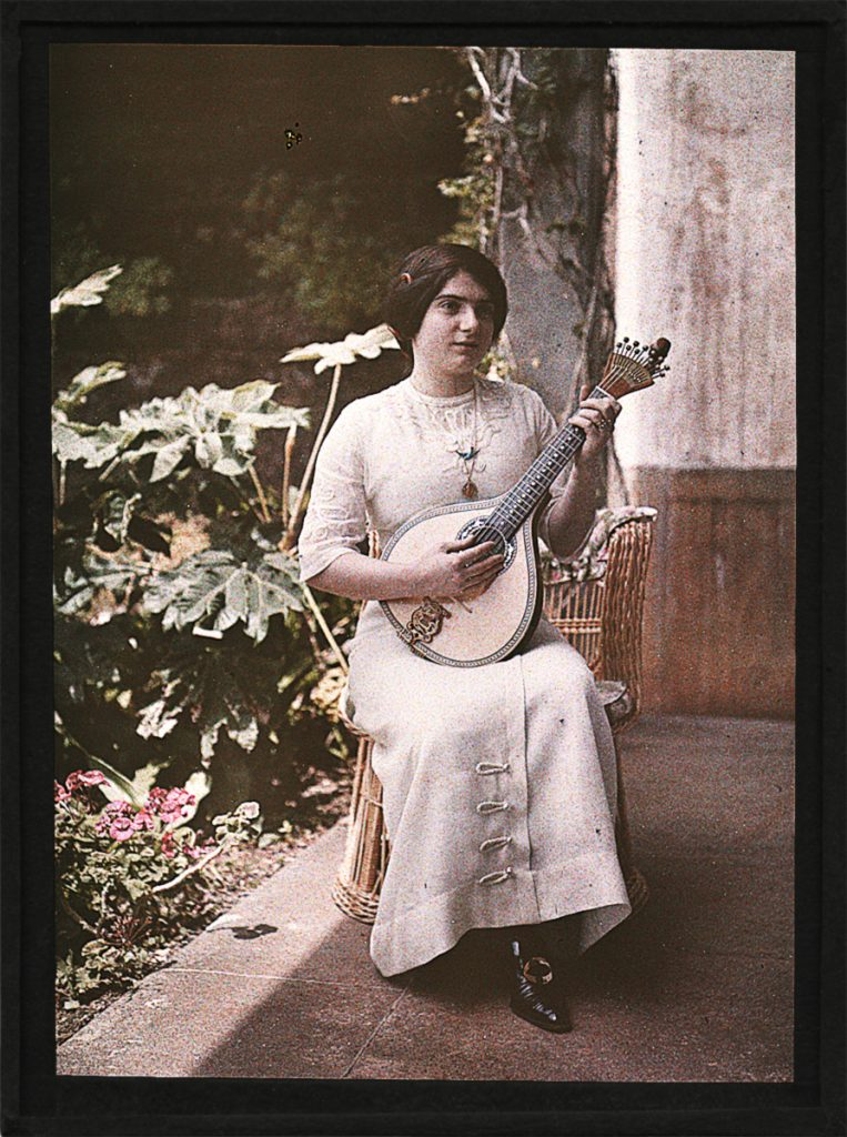 While sitting out the cholera in Madiera one of Miss Acland's occupations was learning to play the Portuguese guitarra.  Sarah Angelina Acland, Unknown woman playing a Portuguese guitarra (autochrome, 1911 or 1912?) HSM, Inventory no. 19113